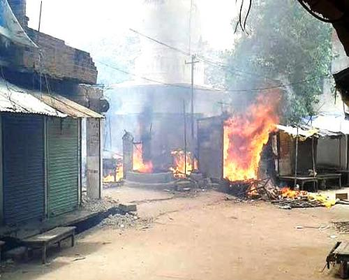 1.Shops belonging to Muslims that were set afire at Mahoba in Jhansi district of Uttar Pradesh on Sunday, 5 July 2015. (Photo: Dainik Bhaskar).